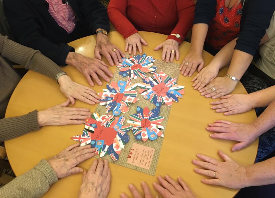 Using creative nursing home activities to make memory books to look back on and share